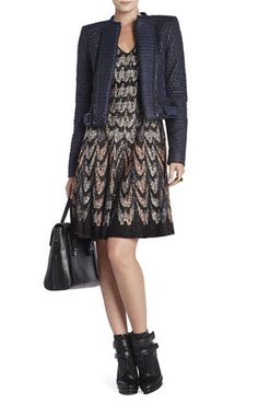 This quilted moto jacket with the feather print short sleeve sweater dress is the perfect addition to your fall closet!  Call us to order today! (617) 963-0469