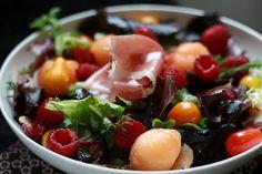 Spring salad with cantaloupe, raspberries, prosciutto and white balsamic vinaigrette.