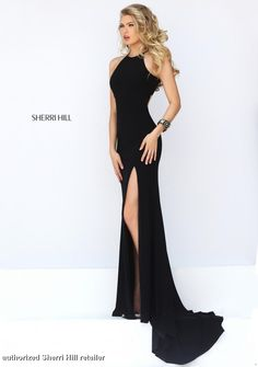 32340 Sherri Hill. Sherri Hill prom 2016. prom 2016. Sherri Hill designs. long, black prom dress with a slit up the leg. get prom ready. accessorize for prom. prom fit.