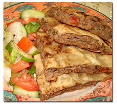 Stuffed Pita Bread ~ This grilled sandwich is equivalent of a burger, and is usually served with humus or green salad. Feel free to create your own version by using different spices and herbs. You can also replace the beef with turkey or chicken. Lebanese Recipes, Turkish Recipes, Indian Food Recipes, Beef Recipes, Cooking Recipes, Syrian Recipes, Arabic Recipes, Lebanese Cuisine, Hamburger Recipes