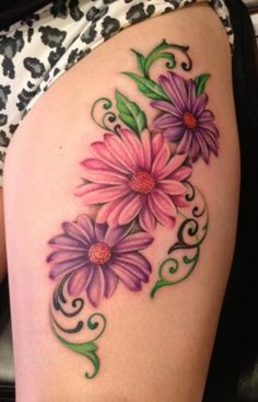 Among the flower tattoos, daisy designs have the most colorful patterns. You can find daisy tattoos of various colors by many people. Daisy Tattoo Designs, Daisy Flower Tattoos, Rose Tattoos, Daisies Tattoo, Gerbera Daisy Tattoo, Tattoo Flowers, Butterfly Tattoos, Floral Tattoos, Stomach Tattoos