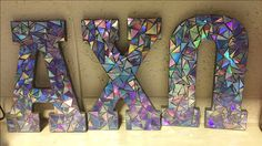 Alpha chi omega Greek letters made with cut up CDs