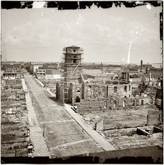 April 1865. Charleston, South Carolina, after bombardment by the Federal Navy. View from roof of the Mills House, looking up Meeting Street at ruins of the Circular Church, damaged in an 1861 fire.