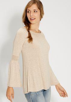 <ul><b>Overview</b><li>soft and stretchy material</li><li>hacci detail</li><li>long bell style sleeves with crochet detail</li><li>ruffled scoop neckline</li><li>flattering cinching around neckline</li></ul><ul><b>Fabric and Care</b><li>Style Number: 81670</li><li>Imported</li><li>95% rayon 5% spandex</li><li>Machine wash</li></ul>