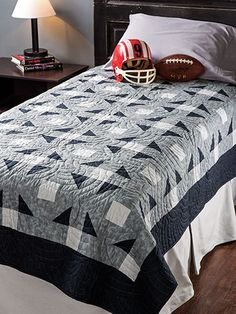 """Perfect for that young man in your life.   This traditional quilt was designed with a young man heading off to college in mind. It's extra-long and will fit a dorm bed with room to spare. This e-pattern was originally published in the Summer 2014 issue of  Quilter's World  magazine. Finished size is 63"""" x 99""""."""