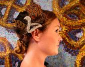This fascinator brings to mind a bird in flight!