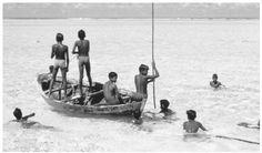 A group of boys fish in the shallow waters off the Maldives Islands. In addition to being an important food source, fish is the nation's greatest export. Visit Maldives, Merchant Navy, Fishing Villages, The Republic, Old Pictures, Tourism, Ocean, Boat, Culture