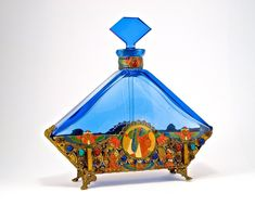 c1930 Czechoslovakian perfume bottle and stopper, blue crystal, dauber, jeweled and enameled metalwork at neck and all around. *Illustrated in 1920s Ahmed Soliman catalog. 7 1/2 in.