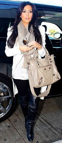 Who made Kim Kardashian's tan handbag, black thigh high boots, white blazer, top, sunglasses, and black skinny jeans that she wore in Los Angeles on January 3, 2011? Shoes – Report Signature  Sunglasses – Chanel  Jacket – Alexander McQueen  Shirt – Balmain  Purse – Balenciaga  Jeans – Siwy