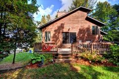 Cottage Vacation Rental - Mallard Beach - Spacious deck at the side of the cottage with lake views!