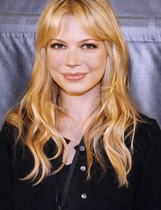 michelle williams. love her long beachy waves and bangs.