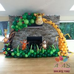 Giraffe Balloon Arch / Balloon tree arch. Safari / Jungle theme balloon decorations + great animal theme party idea!