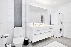 Bathroom with laundry area. Apartment at Kungsgatan 9 L. Via: vastanhem.se