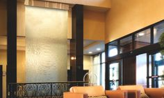A Cascade Coil water feature at the Rockwell Hilton in Boston, MA shows off the harmony created when water meets metal.