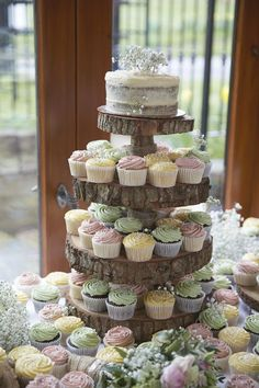 Pastel Cupcake Tower | Rustic Barn Wedding | Lace Mori Lee Wedding Dress | Rachel Simpson Mimosa Shoes | Pastel Green One Shoulder H&M Bridesmaid Dresses | Gypsophila Flower Crown | Images by Natalie J Weddings | http://www.rockmywedding.co.uk/karis-ed/