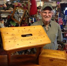 "Choose from a stool or a box! Each one is handmade from Louisiana cypress & says ""Cajun Country"" on the top. $43 each."