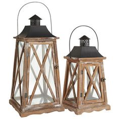 There's something decidedly nautical about our Newport Lantern—but that doesn't mean those with a land-locked abode can't take advantage of its good looks. Handcrafted and painted, the flare-shaped wood structure is finished in distressed brown and accented with black hardware that's treated to be rust-resistant—so functionality remains a shore thing.