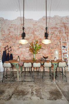 Gorgeous dining space at Tomboy, Melbourne. Exposed brick, timber table, industrial lights... Beautiful.