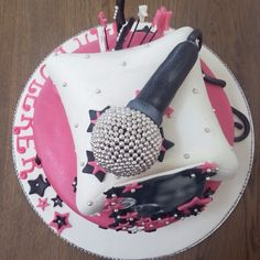 Music cake . Music themed cake for a birthdaygirl . Microphone . Music notes . Stars . Edible picture . Pillow cake . Pink . Black . White . Silver . Pearls . Birthday cake . Oreo . Chocolate buttercream . Chocolate cake . Marzipan .