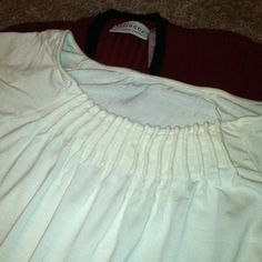 Comfortable Shirt Off white comfortable shirt, form fitting and has plenty of stretch, great neckline for character, I lost weight and do not fit into, excellent condition Tops