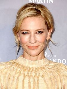 Cate Blanchett effortless side-part updo hairstyle with a rosy complexion, brown smoky eye, and nude lipstick | allure.com