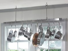 14 Easy Ways to Organize Small Stuff in the Kitchen: When trying to find a place to fit all those pots and pans, don't forget to look up. Install a hanging rack, and keep these kitchen essentials out of the way but within easy reach. From DIYnetwork.com