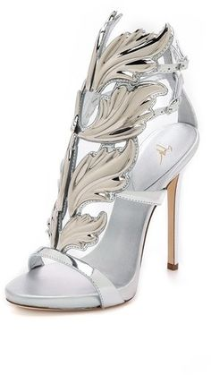 Giuseppe Zanotti Metal Wing Sandals.  Gleaming wing-like plates trim the front of these mirrored leather Giuseppe Zanotti sandals, lending a striking, sculptural finish to the pair. Buckled, double ankle strap. Covered platform and stiletto heel. Leather sole.