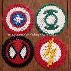 Set of 4 super hero coasters made from hama beads. Designs includes The Flash, Spiderman, Captain America and the Green Lantern. Each measure 3 1/4