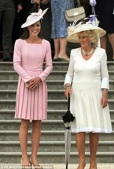 The Duchess of Cambridge and the Duchess of Cornwall attend a garden party at Buckingham Palace in May 2012 and Kate wears a pale pink Emilia Wickstead dress