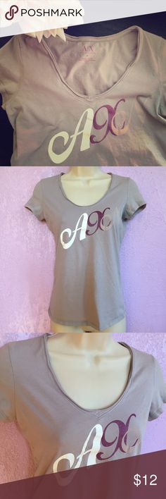 """Armani Exchange Lavender Tee Armani Exchange Tee Color is lavender/gray with white, purple, & lavender lettering  Silver logo across the back shoulders 100% Puma cotton  Armpit to armpit 16"""" Length from top to bottom 22"""" Great condition A/X Armani Exchange Tops Tees - Short Sleeve"""