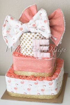 Such a fun pink, coral and gold Flamingo diaper cake. **PLEASE LEAVE DATE YOU NEED CAKE IN NOTES TO SELLER AT CHECKOUT**** This original diaper cake is created using 80 individually rolled size 1 Pampers diapers, 3 cotton chenille burp cloths (shown in 2nd and 3rd pic). We use designer prints and super absorbent cotton chenille. Not only are they cute and stylish, but also super FUNCTIONAL! ***If you would like to add a green yarn wrapped baby initial on the bottom tier, include this…