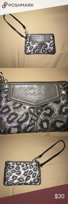 "Black and Silver Cheetah Coach Wrislet Great condition. The ""Coach"" logo is fading but still in good condition. It is black, grey, and silver. Coach Bags Clutches & Wristlets"
