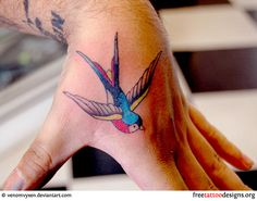 Old school swallow tattoo on hand