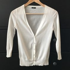 J. Crew white lightweight cotton cardigan Thin cotton J. Crew cardigan in white. Perfect for layering over sundresses or camisoles. Lightweight for summer! J. Crew Sweaters Cardigans