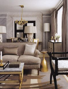 Neutral living room with gold accents by Jean Louis Deniot.