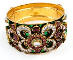 Four Corners Kada - Kundan red and green encrusted with white stones.     Perfect accessory to add some Indian Flair to any LBD