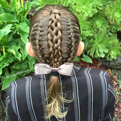 This is a style we have done before but with different braids. Today French braids with a seven strand over the top. First day back at school after holidays and we are hoping for a great day!
