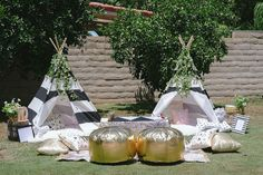 Lounge Tepee and Gold Poof Pillows Nestled Under Fruit Trees