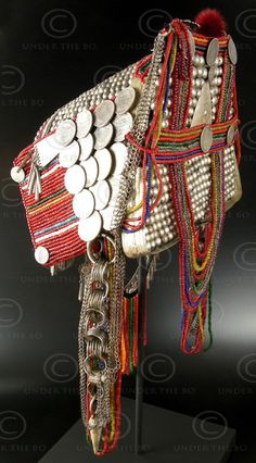 Burma |  Phami-Akha minority headdress; Silver, including British Empire rupees, indigo handspun cotton, wood, glass beads, dyed chicken's feathers.  Shan State | 4,264$