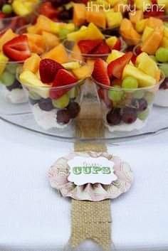 Individual fruit cups, and veggie cups with a healthy hummus dip.