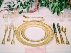 gold white place settings - photo by Milton Photography http://ruffledblog.com/blooming-wedding-inspiration