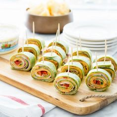 The perfect party food- sandwich pinwheels stuffed with ham, cheese, roasted red peppers and hummus! These things are so addictive!