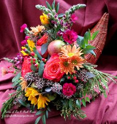 DIY  ~  Thanksgiving Cornucopia http://ourfairfieldhomeandgarden.com/happy-thanksgiving-make-a-cornucopia-of-fresh-fruit-flowers-for-a-centerpiece/