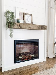 Add cozy ambiance to any room with this budget friendly DIY fireplace. For under… - Modern Farmhouse Fireplace, Home Fireplace, Fireplace Remodel, Living Room With Fireplace, Fireplace Design, Home Living Room, Shiplap Fireplace, Fireplace Ideas, Rustic Farmhouse