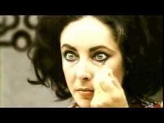 Elizabeth Taylor doing her eye makeup