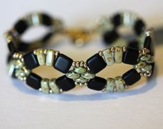 My original design Trellis is a beadwoven bracelet of Tile and Brick Beads with Superduo Beads in the color pictured. Accented with seed beads.
