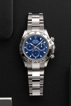 Celebrate the New Year's Eve in the best possible company by opting for an exceptional wristwatch like this special edition of the Rolex Daytona with the reference number 116509. Show the whole world and the New Year that you're not just wearing any Daytona, but a special one in white gold and a blue dial. Buy Rolex, Rolex Models, Luxury Watch Brands, Rolex Daytona, Good Company, Rolex Watches, Eve, White Gold, Number