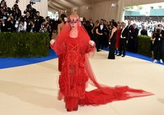 Katy Perry Wears a Dramatic Red Veiled Look to the Met Gala