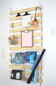 A slatted bed base becomes a wall-mounted storage solution for the home office - bonus points for being both stylish and functional.