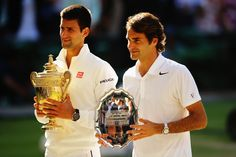 Novak Djokovic of Serbia poses with the Gentlemen's Singles Trophy next to Roger Federer of Switzerland following his victory in the Gentlemen's Singles Final match on day thirteen of the Wimbledon Lawn Tennis Championships at the All England Lawn Tennis and Croquet Club on July 6, 2014 in London, England. (Photo by Al Bello/Getty Images (Photo by Al Bello/Getty Images)